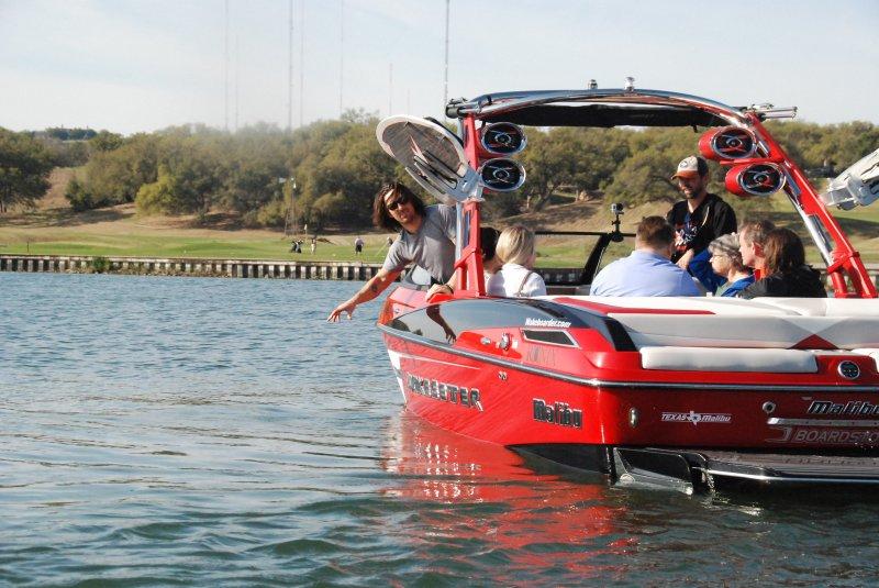 Jake Owen testing the waters of Lake Austin